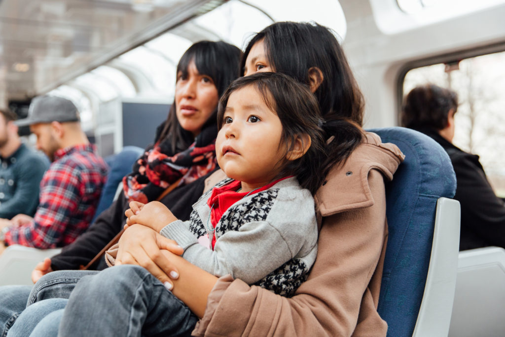 Family with little child on Amtrak train